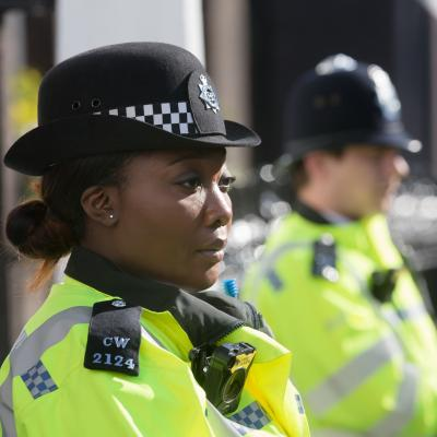 Two police officers - a black woman and a white man
